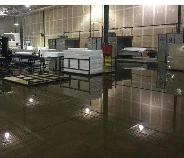 Inside of a commercial facility flooded